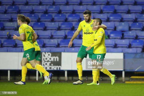 Emi Buendia of Norwich City celebrates after scoring their team's first goal with Grant Hanley during the Sky Bet Championship match between Reading...