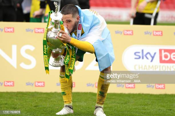 Emi Buendia of Norwich City celebrates by kissing the Sky Bet Championship trophy during the Sky Bet Championship match between Barnsley and Norwich...