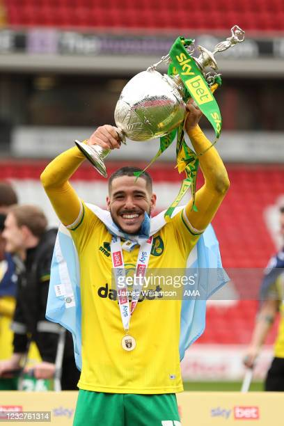Emi Buendia of Norwich City celebrates lifting the Sky Bet Championship trophy during the Sky Bet Championship match between Barnsley and Norwich...