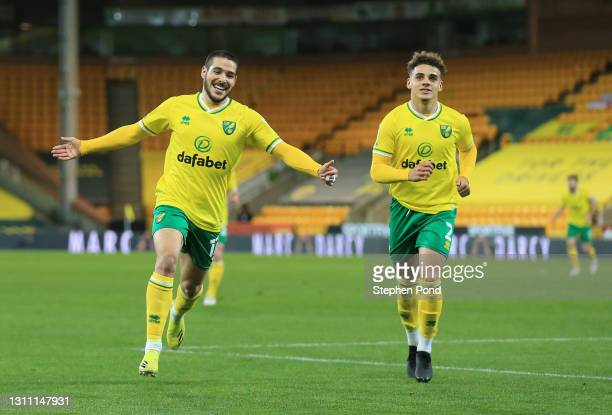 Emi Buendia of Norwich City celebrates with teammate Max Aarons after scoring their team's third goal during the Sky Bet Championship match between...