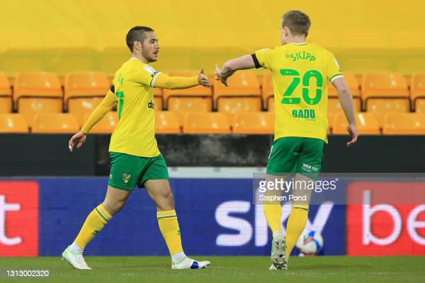 Emi Buendia of Norwich City celebrates with teammate Oliver Skipp after scoring their side's first goal during the Sky Bet Championship match between...