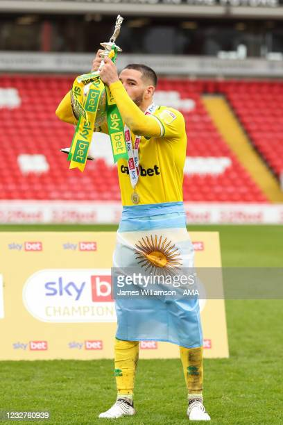 Emi Buendia of Norwich City celebrates with the Sky Bet Championship trophy during the Sky Bet Championship match between Barnsley and Norwich City...