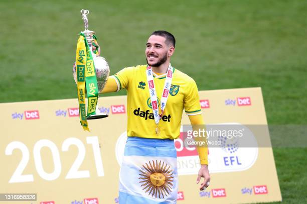 Emi Buendia of Norwich City celebrates with the Sky Bet Championship trophy after the Sky Bet Championship match between Barnsley and Norwich City at...