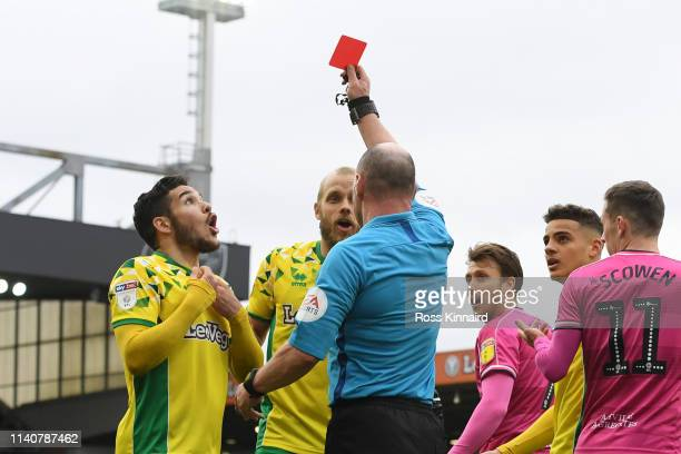 Emi Buendia of Norwich City is shown a red card by referee Scott Duncan and is sent off during the Sky bet Championship match between Norwich City...