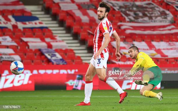 Emi Buendia of Norwich City scores their first goal during the Sky Bet Championship match between Stoke City and Norwich City at Bet365 Stadium on...