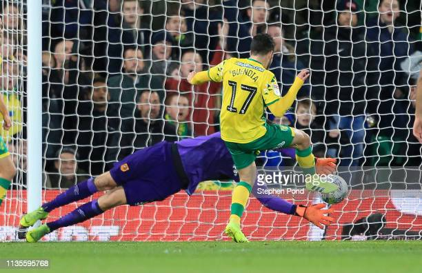 Emi Buendia of Norwich scores to make it 20 during the Sky Bet Championship match between Norwich City and Hull City at Carrow Road on March 13 2019...