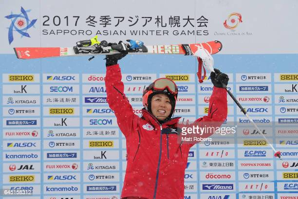 Emi Hasegawa of Japan celebrates first place on the podium after the women's slalom alpine skiing on the day eight of the 2017 Sapporo Asian Winter...