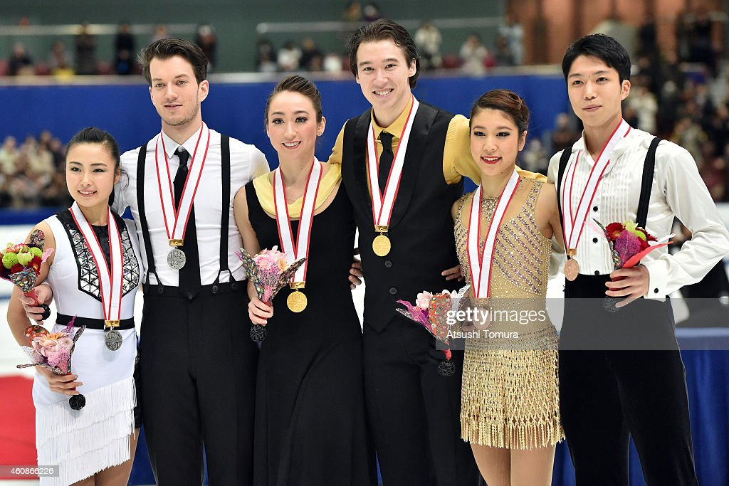 Emi Hirai and Marien De La Asuncion (Silver), Cathy Reed and Chris Reed (Gold) and Kana Muramoto and Hiroichi Noguchi (Bronze) pose in the award ceremony for Ice Dance during the 83rd All Japan Figure Skating Championships at the Big Hat on December 28, 2014 in Nagano, Japan.