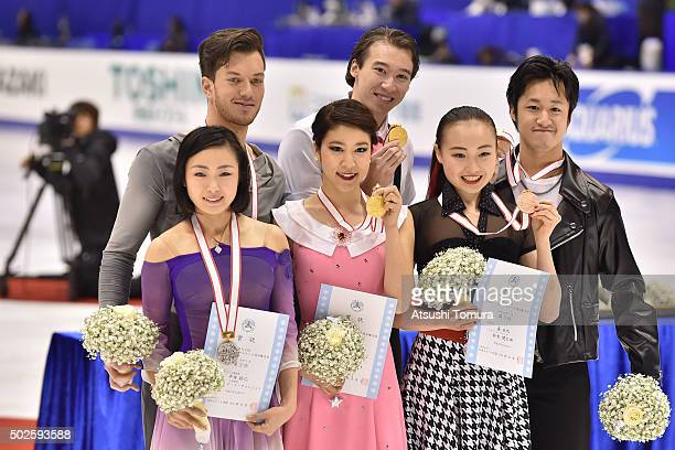Emi Hirai and Marien De La Asuncion Kana Muramoto and Chris Reed and Ibuki Mori and Kentaro Suzuki of Japan pose with their medals during the day...