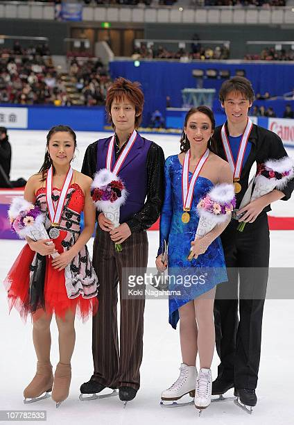 Emi Hirai and Taiyo Mizutani with Cathy Reed and Chris Reed pose for photographs at the medal ceremony during the All Japan Figure Skating...