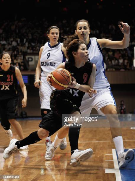 Emi Kudeken of Japan drives past the defence during the women's basketball friendly match between Japan and Slovakia at Yoyogi Gymnasium on May 21...
