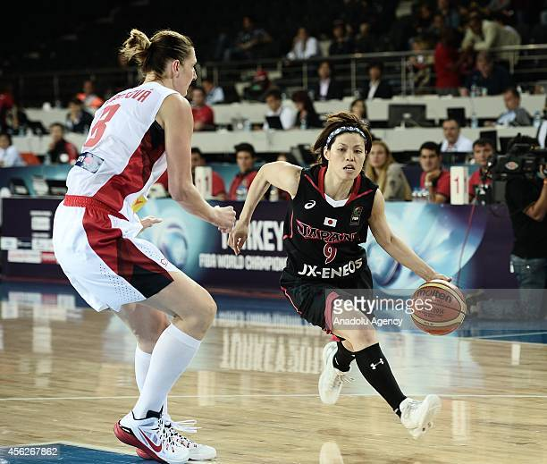 Emi Kudeken of Japan drives towards the hoop against her rival Ilona Burgova during the 2014 FIBA World Championship for Women Group A game between...