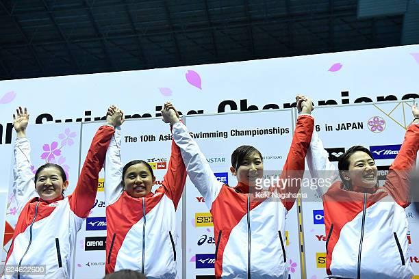 Emi Moronuki and Misaki Sekiguchi and Rikako Ikee and Tomomi Aoki of Japan celebrate on the podium in 4x100m Medley Relay final during the 10th Asian...