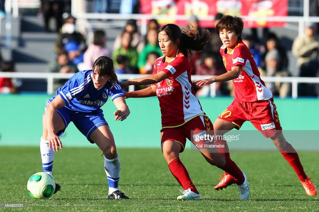 Emi Nakajima of INAC Kobe Leonessa and Rachel Williams of Chelsea Ladies compete for the ball during the International Women's Club Championship final match between Chelsea Ladies and INAC Kobe Leonessa at Ajinomoto Field Nishigaoka on December 8, 2013 in Tokyo, Japan.