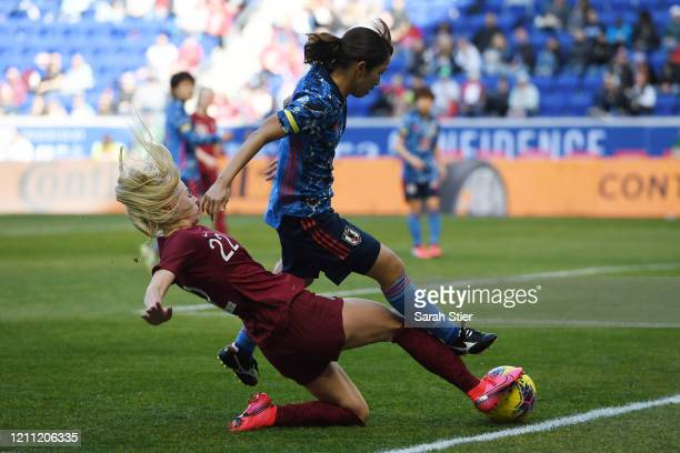 Emi Nakajima of Japan attempts to steal the ball away from Chloe Kelly of England during the second half in the SheBelieves Cup at Red Bull Arena on...