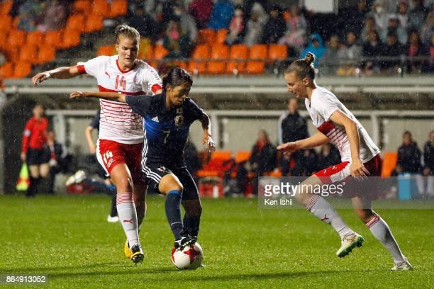 Emi Nakajima of Japan competes for the ball against Rahel Kiwic and Julia Stierli of Switzerland during the international friendly match between...
