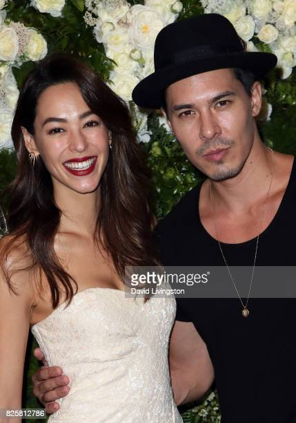 Emi Renata and actor Lewis Tan attend the Maison StGermain LA debut hosted by Lily Kwong at the Houdini Estate on August 2 2017 in Los Angeles...