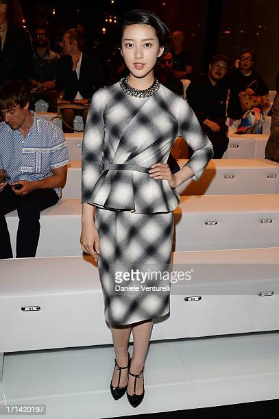 Emi Takei attends the Gucci show during Milan Menswear Fashion Week Spring Summer 2014 show on June 24 2013 in Milan Italy