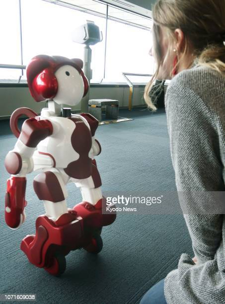 Emiew 3, a 90-centimeter-tall humanoid robot developed by Hitachi Ltd., makes its debut at The Landmark Tower in Yokohama on Dec. 11 in a role to...