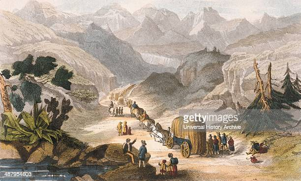 Emigrant party on the road to California 1850 Wagon train of women men and children moving through the mountains