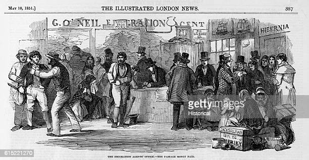 Emigrants gathered at the emigration agents' office near the quays at Cork Ireland to purchase their tickets to America During the 19th century...