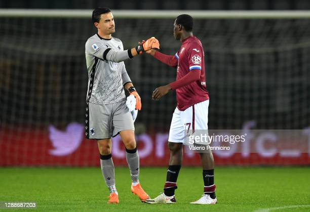 Emil Audero of U.C. Sampdoria shakes hands with Wilfried Singo of Torino F.C. After the final whistle during the Serie A match between Torino FC and...