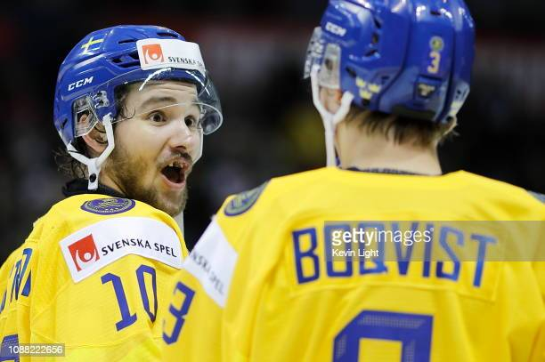 Emil Bemstrom and Adam Boqvist of Sweden celebrate their overtime win versus the United States at the IIHF World Junior Championships at the...