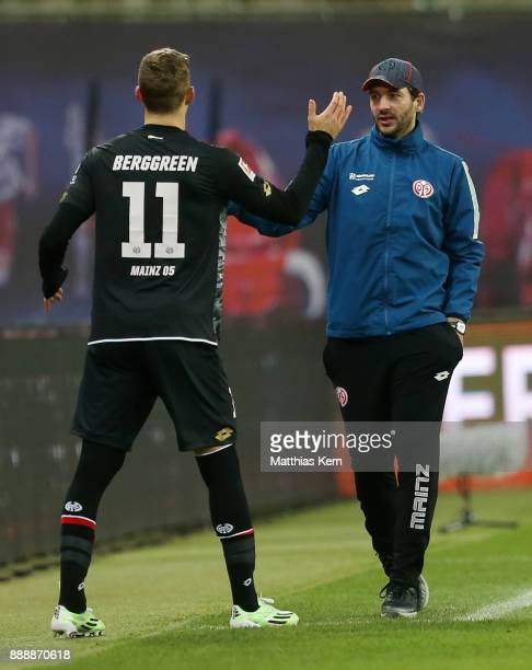 Emil Berggreen of Mainz and head coach Sandro Schwarz look on during the Bundesliga match between RB Leipzig and 1FSV Mainz 05 at Red Bull Arena on...