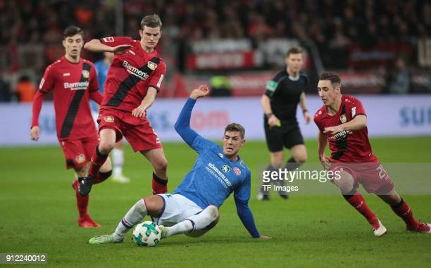 Emil Berggreen of Mainz Dominik Kohr of Leverkusen and Sven Bender of Leverkusen battle for the ball during the Bundesliga match between Bayer 04...