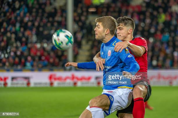 Emil Berggreen of Mainz vies with MarcOliver Kempf of Freiburg during the Bundesliga match between SportClub Freiburg and 1 FSV Mainz 05 at...