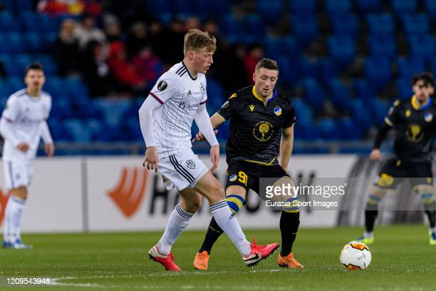 Emil Bergstrom of Basel plays against Dragan Mihajlovic of Apoel during the UEFA Europa League round of 32 second leg match between FC Basel and...