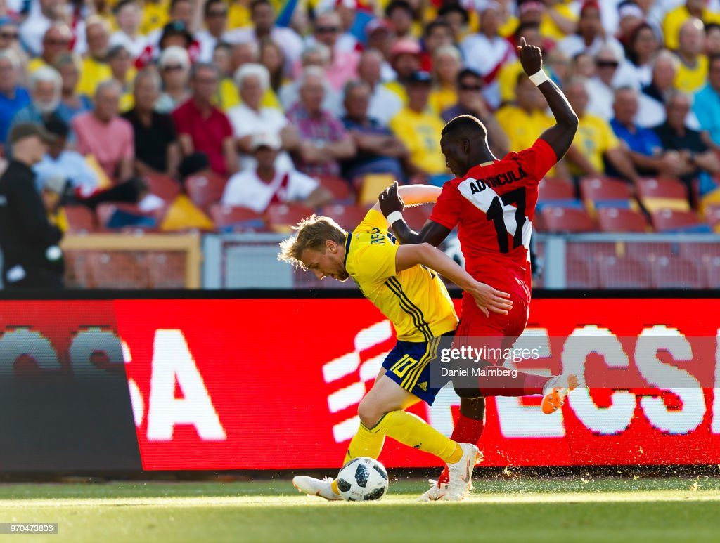 Emil Forsberg and (17) Luis Advincula, battle for the ball during the international friendly match between Sweden v Peru at the Ullevi Stadium on June 9, 2018 in Gothenburg, Sweden.