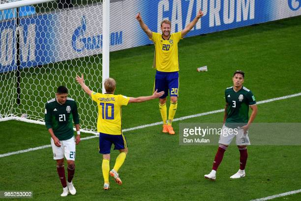 Emil Forsberg and Ola Toivonen of Sweden celebrate their team's third goal an own goal scored by Edson Alvarez of Mexico during the 2018 FIFA World...