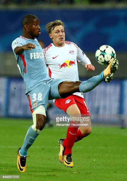 Emil Forsberg of Leipzig and Almamy Touré of Monaco battle for the ball during the UEFA Champions League group G match between RB Leipzig and AS...