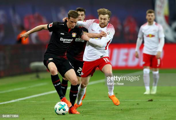 Emil Forsberg of Leipzig and Lars Bender of Leverkusen battle for the ball during the Bundesliga match between RB Leipzig and Bayer 04 Leverkusen at...