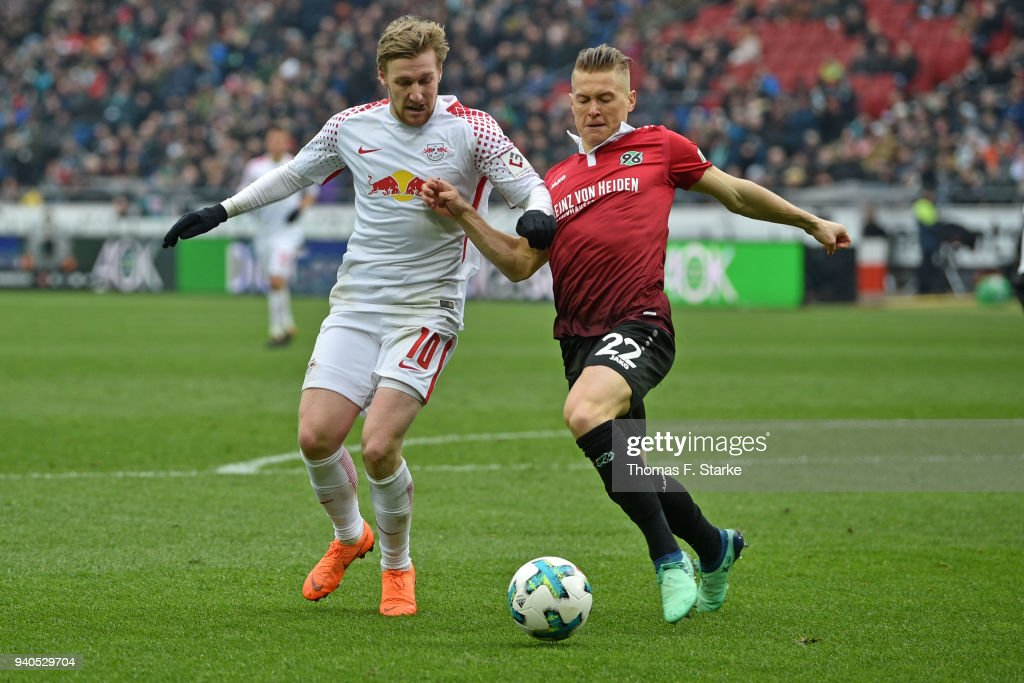 Emil Forsberg (L) of Leipzig and Matthias Ostrzolek of Hannover fight for the ball during the Bundesliga match between Hannover 96 and RB Leipzig at HDI-Arena on March 31, 2018 in Hanover, Germany.