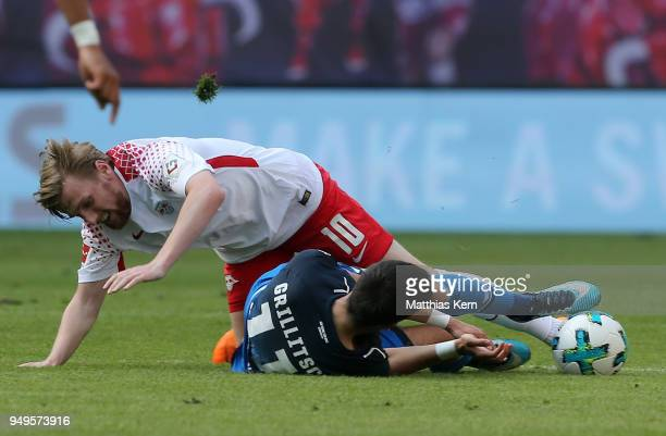 Emil Forsberg of Leipzig battles for the ball with Florian Grillitsch of Hoffenheim during the Bundesliga match between RB Leipzig and TSG 1899...