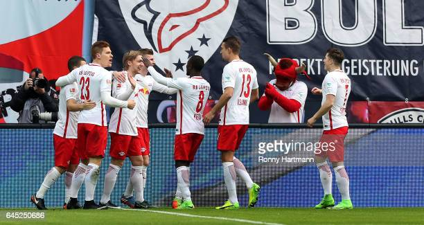 Emil Forsberg of Leipzig celebrates after scoring his team's opening goal with team mates during the Bundesliga match between RB Leipzig and 1 FC...