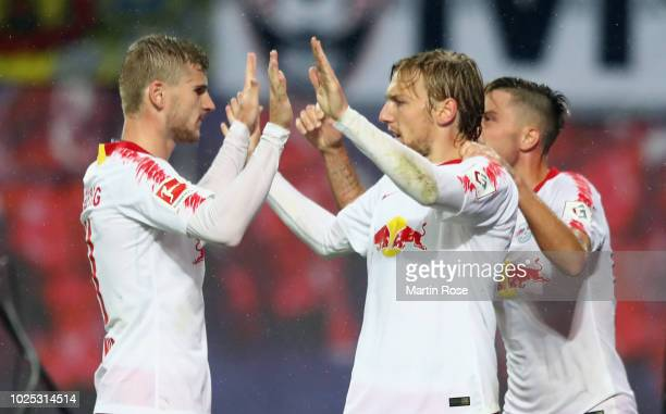 Emil Forsberg of Leipzig celebrates his team's third goal with team mate Timo Werner during the UEFA Europa League Qualifying PlayOff second leg...