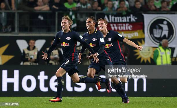 Emil Forsberg of Leipzig celebrates scoring his team's opening goal with Yussuf Poulsen and Marcel Halstenberg of Leipzig during the Bundesliga match...