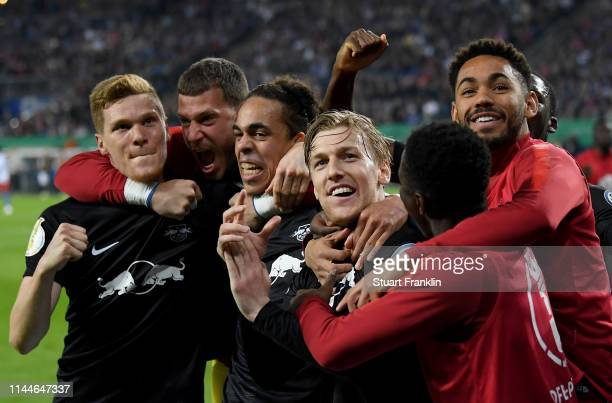 Emil Forsberg of Leipzig celebrates with Yussuf Poulsen of Leipzig and other team mates after scoring his teams third goal during the DFB Cup semi...