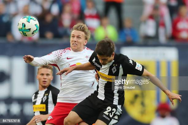 Emil Forsberg of Leipzig fights for the ball with Jonas Hofmann of Moenchengladbach during the Bundesliga match between RB Leipzig and Borussia...