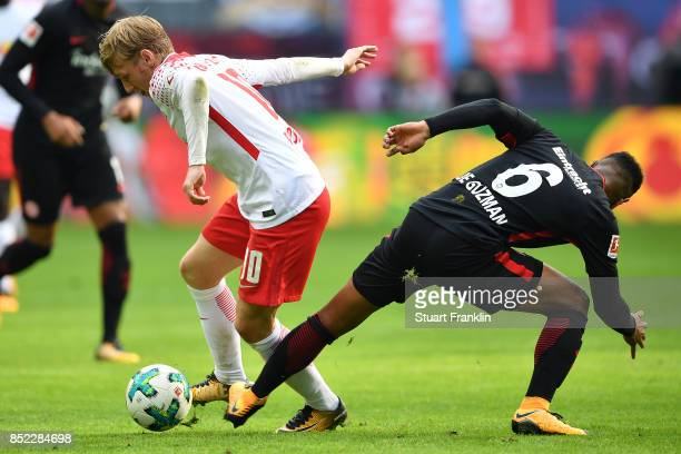 Emil Forsberg of Leipzig fights for the ball with Jonathan de Guzman of Frankfurt during the Bundesliga match between RB Leipzig and Eintracht...