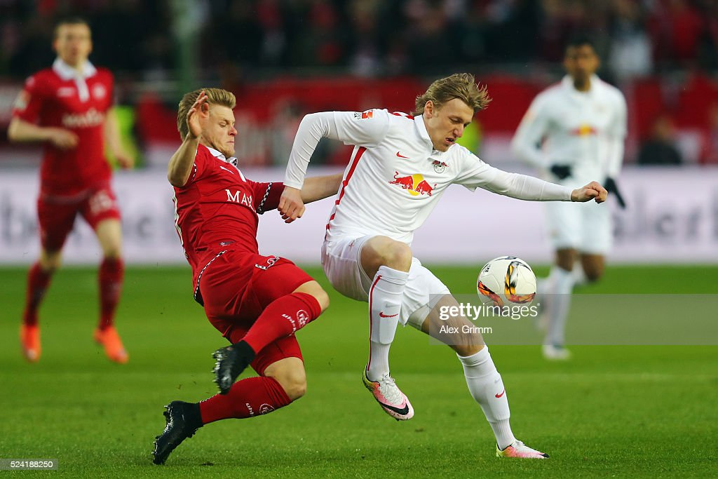 Emil Forsberg of Leipzig is challenged by Jean Zimmer of Kaiserslautern during the Second Bundesliga match between 1. FC Kaiserslautern and RB Leipzig at Fritz-Walter-Stadion on April 25, 2016 in Kaiserslautern, Germany.