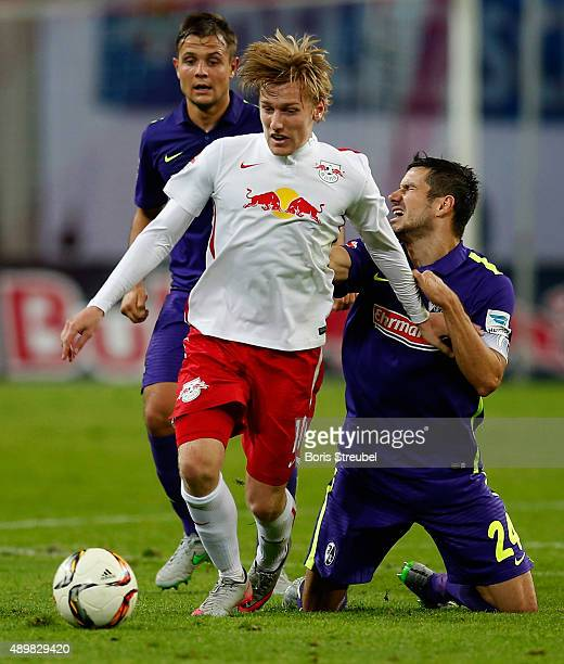 Emil Forsberg of Leipzig is tackled by Mensur Mujdza of Freiburg during the Second Bundesliga match between RB Leipzig and SC Freiburg at Red Bull...