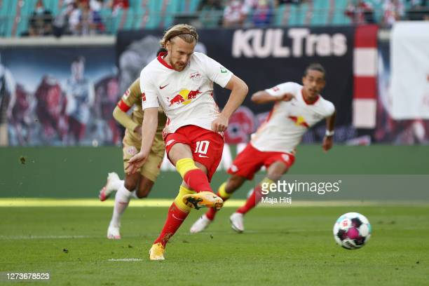 Emil Forsberg of Leipzig scores his team's first goal from the penalty spot during the Bundesliga match between RB Leipzig and 1 FSV Mainz 05 at Red...