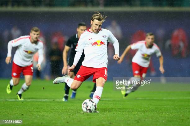 Emil Forsberg of Leipzig scores his team's third goal from the penalty spot during the UEFA Europa League Qualifying PlayOff second leg match between...