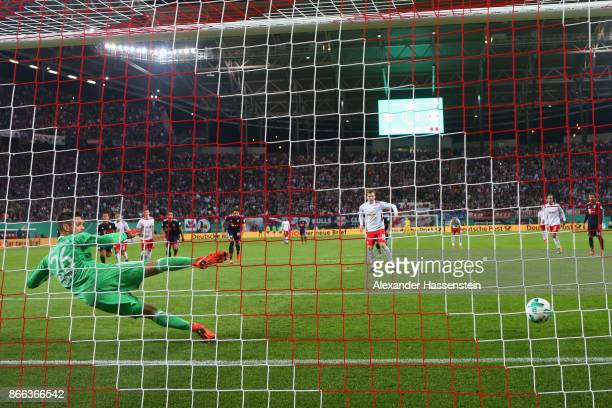 Emil Forsberg of Leipzig scores the opening goal with a penalty against Sven Ulreich keeper of Muenchen during the DFB Cup round 2 match between RB...