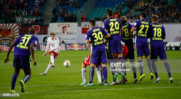 Emil Forsberg of Leipzig takes a freekick during the Second Bundesliga match between RB Leipzig and SC Freiburg at Red Bull Arena on September 24...