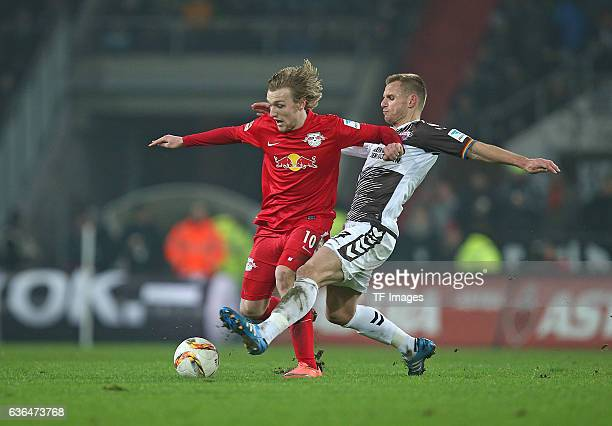 Emil Forsberg of RB Leipzig and Bernd Nehrig of St Pauli battle for the ball during the Second Bundesliga match between FC St Pauli and...